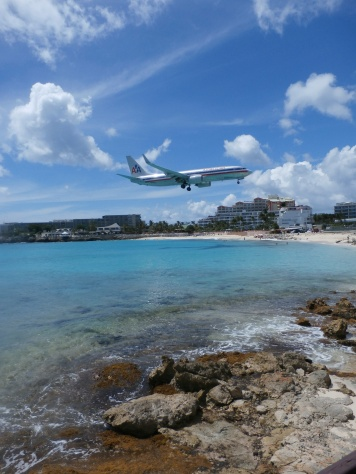 The American morning flight lands feet above the warm, clear waters of Maho Bay. Kathryn B. Creedy